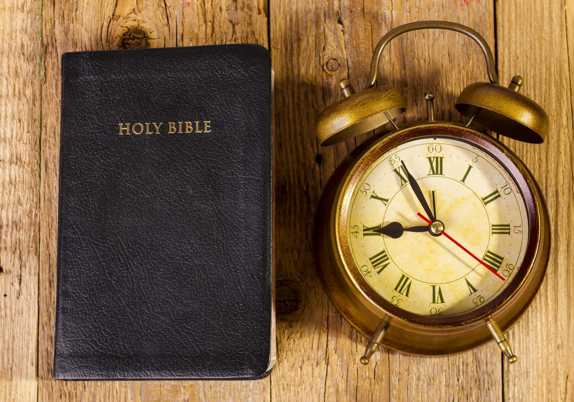 bigstock-Bible-with-Clock-on-Wood-65642572
